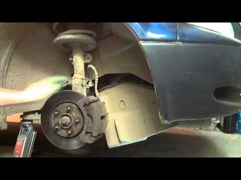 Где находится в Додж Гранд Караван натяжной ролик ремня генератора