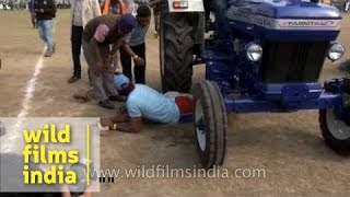 getlinkyoutube.com-Life threatening sport - men crushed under a tractor at Kila Raipur