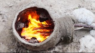 getlinkyoutube.com-Building a primitive clay rocket stove - Consrtuction d'un rocket stove en argile