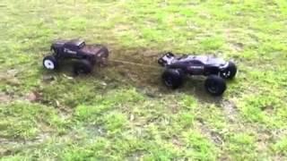 getlinkyoutube.com-E maxx vs E revo tug of war