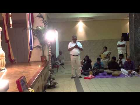 Devotee sharing experience in Tamil at Babaji's satsangh on
