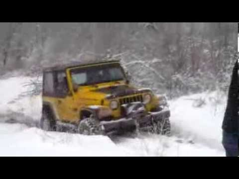 Off road jeep wrangler in snow