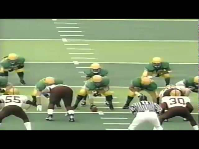 Oregon QB Akili Smith shoves aside a ref while running for 1st down vs. ASU 11-14-98