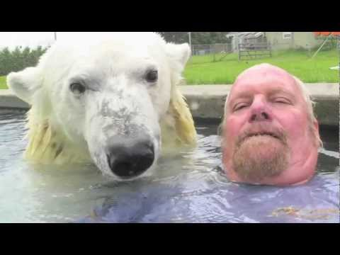 Man Goes Swimming with Pet Polar Bear