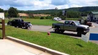 getlinkyoutube.com-Tug of war Ford Raptor vs. Chevy Duramax