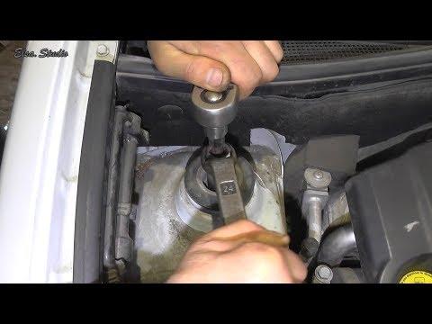 Замена верхней опоры передней стойки и пыльника отбойника Renault Kangoo