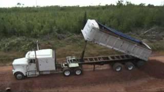 getlinkyoutube.com-Dump Trailer Rolls Over (Trout River)