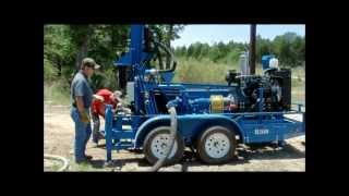 getlinkyoutube.com-RockBuster R100 Portable Water Well Drilling Rig
