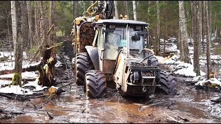 Valtra forestry tractor, John Deere 1110D and Timberjack 810B logging in wet conditions, compilation