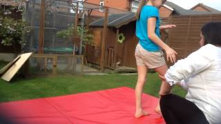 first back handspring on the ground.