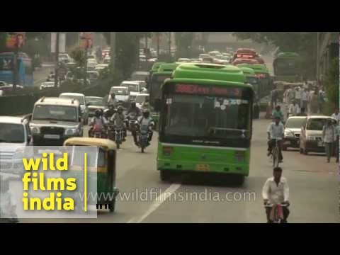 Chaotic traffic moves along a busy road in New Delhi