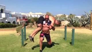 "getlinkyoutube.com-Walking lunges with 93kg ""human barbell"""
