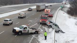 Wrecker pulls car that flew off I75 back over concrete barrier