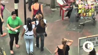 getlinkyoutube.com-Female Pick Pocket Thieves Clean Out Victims In Colombian Streets