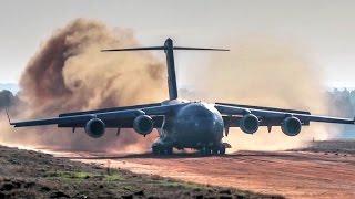 C-17 Dirt Airstrip Landing & Takeoff, Unloads AH-64. width=