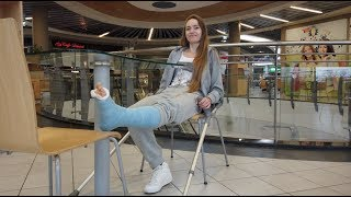 Pretty young girl with a leg in a cast broke the other leg