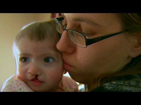 Surrogate mom defies family, has baby