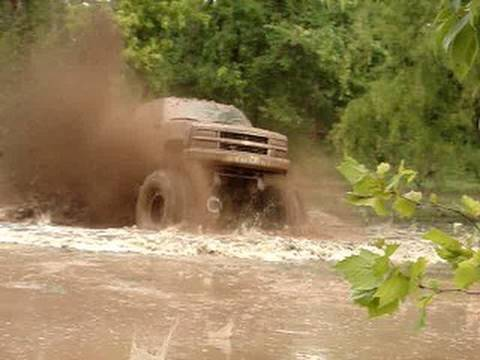 EPIC HUGE CHEVY 4X4 MUD TRUCK BLASTING THROUGH SLOUGH at Red River Mud Bog