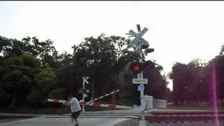 getlinkyoutube.com-CSX Trains Crossing Gate Malfunctions Man Gets Hit On Head