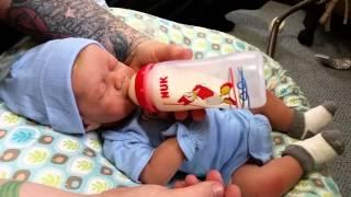 getlinkyoutube.com-First Feeding of Silicone Full Body Baby