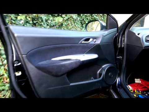 How to remove door panel trim cover