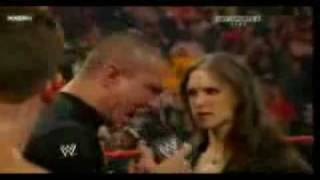 randy orton starts to attack triple H and his family