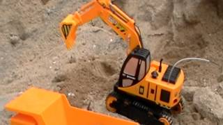 getlinkyoutube.com-Toy RC Dump Truck and Toy RC Shovel Arm Excavator in Action
