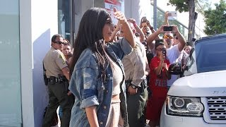 getlinkyoutube.com-Pregnant Kim Kardashian Is Too Busy For Fans At Dash with Khloe And Kourtney