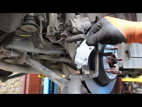 Замена задних тормозных дисков и колодок на Range Rover Evoque 2,2 Ленд Ровер Эвок 2012 года