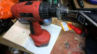 A simple way to release a jammed/locked cordless drill chuck using a thin spanner