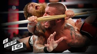 getlinkyoutube.com-Weapon-enhanced submission moves: WWE Top 10