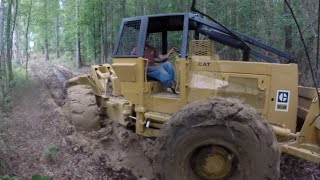 getlinkyoutube.com-Skidder Almost Stuck in the Muck!  Caterpillar Logging Muddy Wet