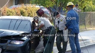 getlinkyoutube.com-Woman Trapped By Electrical Wires After Car Hits Pole, Lemon Grove