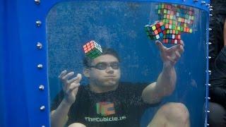 getlinkyoutube.com-Guinness World Record! 8 Rubik's Cubes Solved Underwater