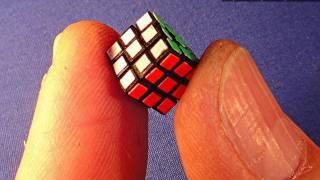getlinkyoutube.com-Assembling the World's Smallest (old) 8mm Rubik's Cube