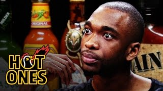 getlinkyoutube.com-Jay Pharoah Has a Staring Contest While Eating Spicy Wings | Hot Ones