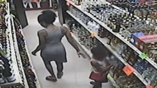 getlinkyoutube.com-Woman Caught On Camera Teaching Child To Steal Liquor (Video)