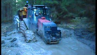 getlinkyoutube.com-Valtra forestry tractor in wet forest