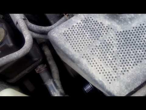 Где натяжной ролик ремня генератора у Шкода Рапид