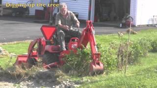 getlinkyoutube.com-Kubota BX tree transplanter