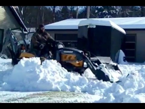 Plowing snow with homemade plow mounted on 4x4 tractor yanmar sc2450 2400 bucket loader