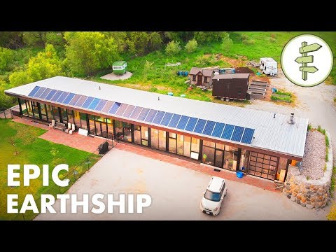 Man Living in a Sustainable & Innovative Earthship Home