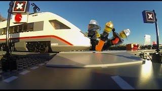getlinkyoutube.com-How many people can stop a Lego train?