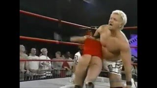 Dusty Rhodes spanks Trinity in thong