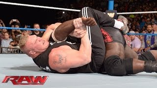 getlinkyoutube.com-Brock Lesnar dislocates Mark Henry's elbow: Raw, Jan. 6, 2014