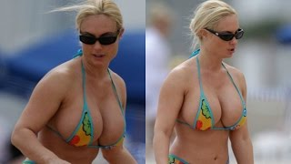 getlinkyoutube.com-Croatian President Kolinda Grabar Kitarovic Hot Bikini Cleavage