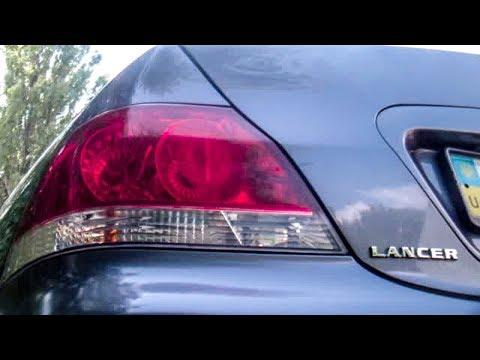 Снятие заднего фонаря с Мицубиси Лансер 9 (Mitsubishi Lancer 9 ). Замена лампочек заднего фонаря .