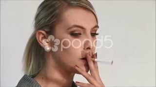 getlinkyoutube.com-Young business woman smoking a cigarette