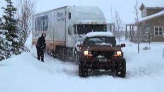 getlinkyoutube.com-lifted wj jeep pulling a 50' semi truck