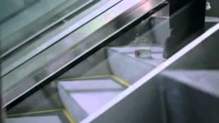 getlinkyoutube.com-GEICO Slinky Commercial - Happier Than A Slinky On An Escalator